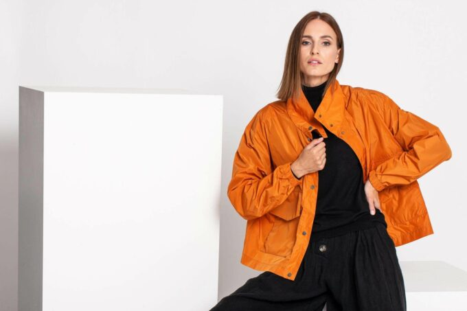 Woman with an orange jacket